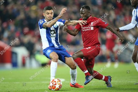 Liverpool midfielder Naby Keita (8) and FC Porto forward Jesus Manuel Corona (17) during the Champions League Quarter-Final Leg 1 of 2 match between Liverpool and FC Porto at Anfield, Liverpool