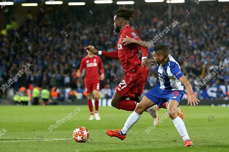 FC Porto forward Jesus Manuel Corona (17) brings down Liverpool forward Divock Origi on the edge of the box during the Champions League Quarter-Final Leg 1 of 2 match between Liverpool and FC Porto at Anfield, Liverpool