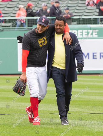 Boston Red Sox starting pitcher Eduardo Rodriguez (L) is embraced by former Boston Red Sox pitcher Pedro Martinez (R) before the start of the Boston Red Sox home opener against the Toronto Blue Jays at Fenway Park in Boston, Massachusetts, USA 09 April 2019.