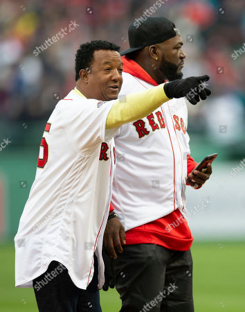 Former Boston Red Sox Pedro Martinez (L) gestures to a fan as he and former Boston Red Sox David Ortiz (R) leave the field following pre-game ceremonies before the start of the Boston Red Sox home opener against the Toronto Blue Jays at Fenway Park in Boston, Massachusetts, USA 09 April 2019.