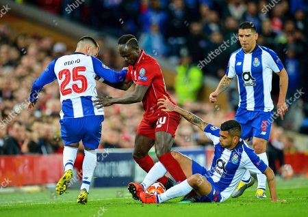 Liverpool's Sadio Mane (C) in action against FC Porto players Jesus Manuel Corona (R) and Otavio (L) during the UEFA Champions League quarter final, first leg soccer match between Liverpool FC and FC Porto at Anfield in Liverpool, Britain, 09 April 2019.
