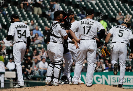 Chicago White Sox starting pitcher Ervin Santana, left, walks off the mound after being pulled by manager Rick Renteria as teammates wait for relief pitcher during the fourth inning of a baseball game against the Tampa Bay Rays in Chicago
