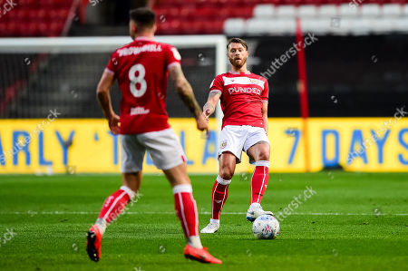 Nathan Baker of Bristol City passes to Josh Brownhill of Bristol City