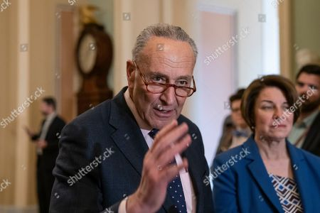 Chuck Schumer, Amy Klobuchar. Senate Minority Leader Chuck Schumer, D-N.Y., joined at right by Sen. Amy Klobuchar, D-Minn., speaks to reporters at the Capitol in Washington