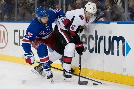 Chris Kreider, Cody Ceci. New York Rangers left wing Chris Kreider (20) and Ottawa Senators defenseman Cody Ceci (5) fights for the puck during the second period of an NHL hockey game, at Madison Square Garden in New York
