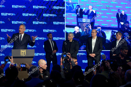 Blue and White party leaders, from the left, Benny Gantz, Yair Lapid, Moshe Yaalon and Gabi Ashkenazi adress their supporters after Israeli general elections polls closed, in Tel Aviv