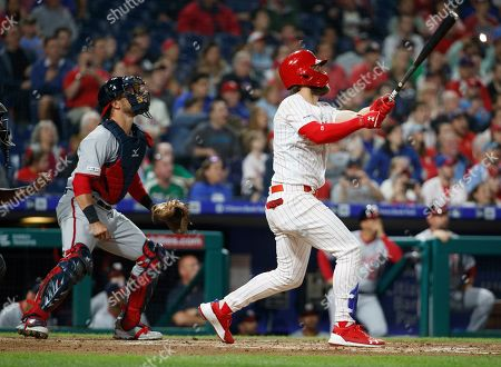 Philadelphia Phillies' Bryce Harper, right, and Washington Nationals catcher Yan Gomes watch his three-run home run during the third inning of a baseball game, in Philadelphia