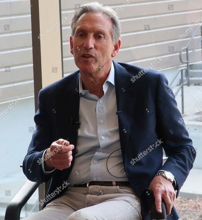 Former Starbucks CEO Howard Schultz, center, speaks about the possibility that he'll run for president as an independent candidate during a town hall meeting on the University of Kansas campus in Lawrence, Kansas. Schultz believes he would take much of his support from disaffected Republicans