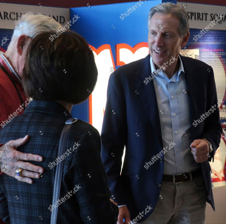 Stock Picture of Former Starbucks CEO Howard Schultz, right, greets well-wishers before a tour of a museum dedicated to University of Kansas athletics at the famed Allen Fieldhouse basketball arena, in Lawrence, Kansas. Schultz has launched a heartland tour about his potential bid for president in Kansas and held a town hall on the University of Kansas campus