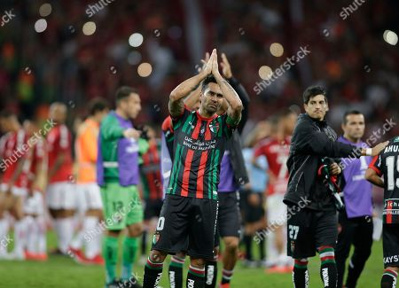 Stock Image of Luis Jimenez of Chile's Palestino applauds at the end of a Copa Libertadores soccer match against Brazil's Internacional in Porto Alegre, Brazil, . International won 3-2