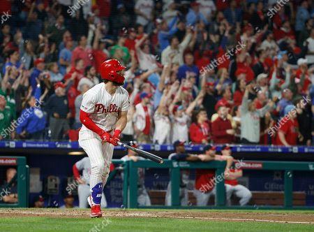 Philadelphia Phillies' Bryce Harper hits a three run home run during the third inning of a baseball game against the Washington Nationals, in Philadelphia