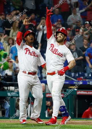Philadelphia Phillies' Bryce Harper, right, reacts to his home run with Jean Segura, left, during the third inning of a baseball game against the Washington Nationals, in Philadelphia