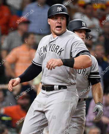 New York Yankees' Luke Voit reacts after scoring a run on Gary Sanchez's two run double during the sixth inning of a baseball game against the Houston Astros, in Houston
