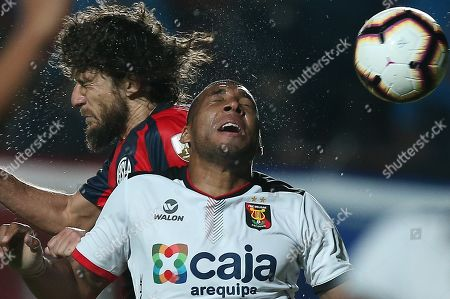 San Lorenzo's Fabricio Coloccini (L) vies for the ball with Melgar's Christian Ramos (R) during the Copa Libertadores group F soccer match between San Lorenzo and Melgar at Pedro Bidegain stadium in Buenos Aires, Argentina, 09 April 2019.