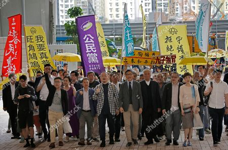 """Tommy Cheung, Tanya Chan, Benny Tai, Chu Yiu-ming, Chan Kin-man, Shiu Ka-chun, Lee Wing-tat, Raphael Wong, Eason Chung. Occupy Central leaders, from right, Tommy Cheung, Tanya Chan, Benny Tai, Chu Yiu-ming, Chan Kin-man, Shiu Ka-chun, Lee Wing-tat, Raphael Wong and Eason Chung arrive at a court in Hong Kong, . Nine pro-democracy activists returned to court Wednesday in Hong Kong to await their verdicts after having been found guilty of various offenses in relation to the 2014 """"Occupy Central"""" protest, which paralyzed city streets in the southern Chinese territory"""