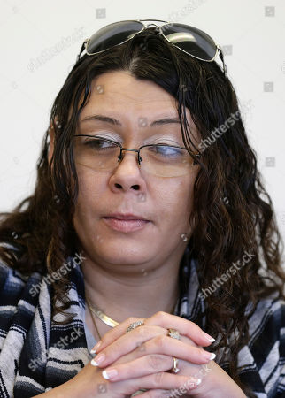 Heather Allen, Lee Wayne Hunt's daughter, listens during an interview in Raleigh, N.C. Even though Lee Wayne Hunt died as a prisoner found guilty of a double murder, his family says he never gave up hope of proving his innocence