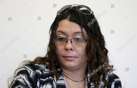 Heather Allen, Lee Wayne Hunt's daughter, pauses during an interview in Raleigh, N.C. Even though Lee Wayne Hunt died as a prisoner found guilty of a double murder, his family says he never gave up hope of proving his innocence