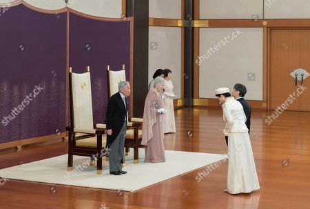 In this photo provided by the Imperial Household Agency, Japan's Emperor Akihito, left, and Empress Michiko, second from left, are greeted by Crown Prince Naruhito, right, and Crown Princess Masako second from right, as they celebrate their 60th wedding anniversary at the Imperial Palace in Tokyo