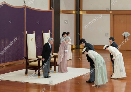 In this photo provided by the Imperial Household Agency, Japan's Emperor Akihito, left, and Empress Michiko, second from left, are greeted by royal members, from right, Crown Prince Naruhito, Crown Princess Masako, Prince Akishino and Princess Kiko during a celebration marking their 60th wedding anniversary at the Imperial Palace in Tokyo