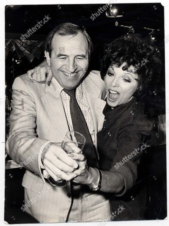 Television Adverts Cinzano 1983 Cinzano Launch Their New Tv Advertising Campaign Which Will Be The Final One In The Long Running Series: Joan Collins And Lennard Rossiter Attend Photocall. It Was An Amazing Admission Even For One As Pracctised At The Art Of Disarming As Leonard Rossiter. After Five Years Of Playing The Hopeless Harry Who Spill Cinzano Over Joan Collins He Revealed Yesterday That He Never Touches The Stuff. . Rexmailpix.
