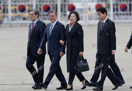 Moon Jae-in, Kim Jung-sook. South Korean President Moon Jae-in, second from left, and his wife Kim Jung-sook arrive to leave for the United States at Seoul Air Base in Seongnam, South Korea, . South Korean President Moon will meet with U.S. President Donald Trump