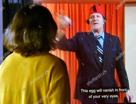 Tommy Cooper performing the egg bag trick, 1975 at Wellcome Collection Smoke and Mirrors exhibition