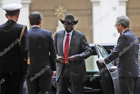 South Sudan President Salva Kiir Mayardit, center, is welcomed by Italian Premier Giuseppe Conte, second from left, upon his arrival at Chigi palace, Government's office, . The Vatican has invited South Sudan's president and opposition leader Riek Machar for a two-day spiritual retreat, attended also by Mayardit, meant to foster peace after the country's five-year civil war and build confidence in its fragile peace deal