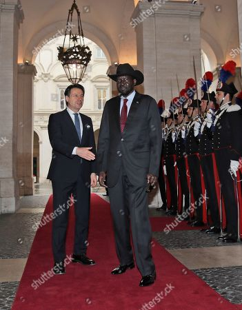 South Sudan President Salva Kiir Mayardit, right, and Italian Premier Giuseppe Conte, go to shake hands during a welcome ceremony at Chigi palace, Government's office, ahead of their meeting, . The Vatican has invited South Sudan's president and opposition leader Riek Machar for a two-day spiritual retreat, attended also by Mayardit, meant to foster peace after the country's five-year civil war and build confidence in its fragile peace deal
