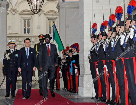South Sudan President Salva Kiir Mayardit, center, and Italian Premier Giuseppe Conte, second from left, review the honor guard during a welcome ceremony at Chigi palace, Government's office, ahead of their meeting, . The Vatican has invited South Sudan's president and opposition leader Riek Machar for a two-day spiritual retreat, attended also by Mayardit, meant to foster peace after the country's five-year civil war and build confidence in its fragile peace deal