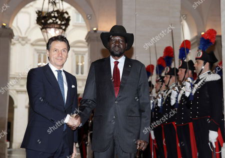 South Sudan President Salva Kiir Mayardit, center, and Italian Premier Giuseppe Conte, shake hands during a welcome ceremony at Chigi palace, Government's office, ahead of their meeting, . The Vatican has invited South Sudan's president and opposition leader Riek Machar for a two-day spiritual retreat, attended also by Mayardit, meant to foster peace after the country's five-year civil war and build confidence in its fragile peace deal