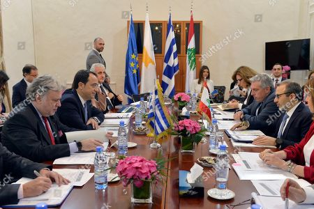 Stock Image of Greek Foreign Minister Giorgos Katrougalos (L) and Cypriot Foreign Minister Nikos Christodoulides (2-L) listen to the Lebanese Foreign Minister Gebran Bassil (R) during a meeting at the Foreign Ministry in Beirut, Lebanon, 10 April 2019. The meeting was held to lay the foundations for enhancing cooperation in the sectors of tourism, education, economy, trade and strengthening the EU?s relations with Lebanon, bilateral relations, the refugee issue, energy and international issues.