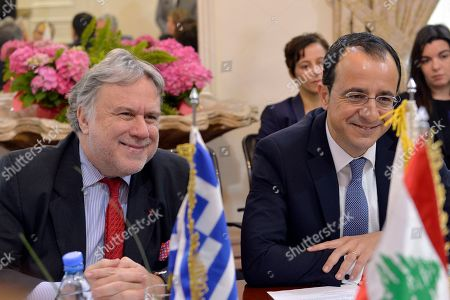 Greek Foreign Minister Giorgos Katrougalos (L) and Cypriot Foreign Minister Nikos Christodoulides (R) listen to Lebanese Foreign Minister Gebran Bassil (not pictured) during a meeting at the Foreign Ministry in Beirut, Lebanon, 10 April 2019. The meeting was held to lay the foundations for enhancing cooperation in the sectors of tourism, education, economy, trade and strengthening the EU?s relations with Lebanon, bilateral relations, the refugee issue, energy and international issues.