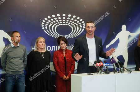 Former world heavyweight champion Wladimir Klitschko (R) speaks as he presents the VADA experts on the Olimpiyskiy stadium in Kiev, Ukraine, 10 April 2019. Experts from the Voluntary Anti-Doping Association (VADA) have arrived in Ukraine at the invitation of Ukrainian boxer Wladimir Klitschko. The experts came to carry out a health check-up for two leading presidential candidates, incumbent President Petro Poroshenko and showman Volodymyr Zelensky, if they give their consent. Zelensky on 03 April 2019 declared his readiness to come to the debate with Poroshenko ahead of the April 21 runoff, however, he voiced a number of conditions. In particular, he said the debates should be held at Kyiv's Olimpiyskiy Stadium with all TV channels being able to air the event live, while both candidates must undergo medical tests to prove there are 'no alcohol or drug addicts' among them. Poroshenko agreed to hold the debate with Zelensky at the stadium. On 05 April 2019, Zelensky had blood tests at a private clinic, Eurolab. Poroshenko in turn had relevant tests at the Olimpiyskiy health center. Wladimir Klitschko called the presidential candidates' medical tests ridiculous and offered to arrange new drug testing at VADA.