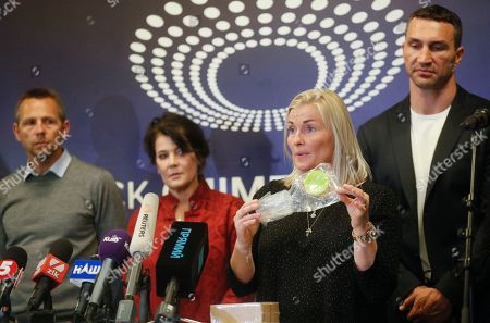 Gitte Pedersen (2-R), the expert of VADA explains the process of testing to journalists on the Olimpiyskiy stadium in Kiev, Ukraine, 10 April 2019. Experts from the Voluntary Anti-Doping Association (VADA) have arrived in Ukraine at the invitation of Ukrainian boxer Wladimir Klitschko. The experts came to carry out a health check-up for two leading presidential candidates, incumbent President Petro Poroshenko and showman Volodymyr Zelensky, if they give their consent. Zelensky on 03 April 2019 declared his readiness to come to the debate with Poroshenko ahead of the April 21 runoff, however, he voiced a number of conditions. In particular, he said the debates should be held at Kyiv's Olimpiyskiy Stadium with all TV channels being able to air the event live, while both candidates must undergo medical tests to prove there are 'no alcohol or drug addicts' among them. Poroshenko agreed to hold the debate with Zelensky at the stadium. On 05 April 2019, Zelensky had blood tests at a private clinic, Eurolab. Poroshenko in turn had relevant tests at the Olimpiyskiy health center. Wladimir Klitschko called the presidential candidates' medical tests ridiculous and offered to arrange new drug testing at VADA.