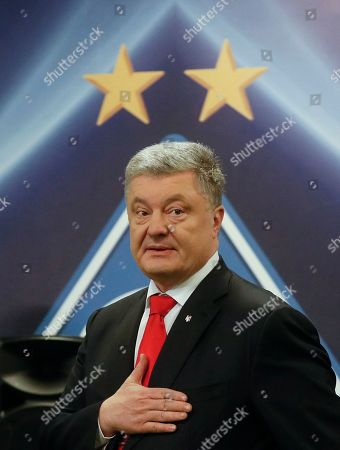 Acting Ukrainian President and Presidential candidate Petro Poroshenko reacts after the VADA medical test on the Olimpiyskiy stadium in Kiev, Ukraine, 10 April 2019. Experts from the Voluntary Anti-Doping Association (VADA) have arrived in Ukraine at the invitation of Ukrainian boxer Wladimir Klitschko. The experts came to carry out a health check-up for two leading presidential candidates, incumbent President Petro Poroshenko and showman Volodymyr Zelensky if they give their consent. Zelenskiy on 03 April 2019 declared his readiness to come to the debate with Poroshenko ahead of the April 21 runoff, however, he voiced a number of conditions. In particular, he said the debates should be held at Kyiv's Olimpiyskiy Stadium with all TV channels being able to air the event live, while both candidates must undergo medical tests to prove there are 'no alcohol or drug addicts' among them. Poroshenko agreed to hold the debate with Zelensky at the stadium. On 05 April 2019, Zelenskiy had blood tests at a private clinic, Eurolab. Poroshenko, in turn, had relevant tests at the Olimpiyskiy health center. Wladimir Klitschko called the presidential candidates' medical tests ridiculous and offered to arrange new drug testing at VADA.