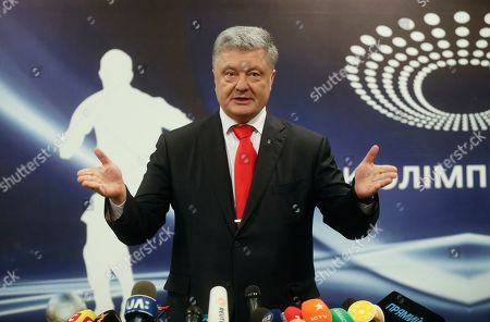 Stock Photo of Acting Ukrainian President and Presidential candidate Petro Poroshenko speaks with media after VADA medical test on the Olimpiyskiy stadium in Kiev, Ukraine, 10 April 2019. Experts from the Voluntary Anti-Doping Association (VADA) have arrived in Ukraine at the invitation of Ukrainian boxer Wladimir Klitschko. The experts came to carry out a health check-up for two leading presidential candidates, incumbent President Petro Poroshenko and showman Volodymyr Zelensky if they give their consent. Zelenskiy on 03 April 2019 declared his readiness to come to the debate with Poroshenko ahead of the April 21 runoff, however, he voiced a number of conditions. In particular, he said the debates should be held at Kyiv's Olimpiyskiy Stadium with all TV channels being able to air the event live, while both candidates must undergo medical tests to prove there are 'no alcohol or drug addicts' among them. Poroshenko agreed to hold the debate with Zelensky at the stadium. On 05 April 2019, Zelenskiy had blood tests at a private clinic, Eurolab. Poroshenko, in turn, had relevant tests at the Olimpiyskiy health center. Wladimir Klitschko called the presidential candidates' medical tests ridiculous and offered to arrange new drug testing at VADA.