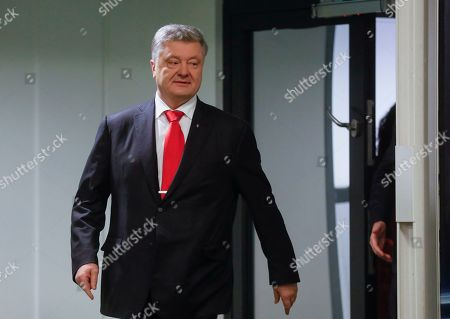Acting Ukrainian President and Presidential candidate Petro Poroshenko leaves a room for testing after VADA medical test on the Olimpiyskiy stadium in Kiev, Ukraine, 10 April 2019. Experts from the Voluntary Anti-Doping Association (VADA) have arrived in Ukraine at the invitation of Ukrainian boxer Wladimir Klitschko. The experts came to carry out a health check-up for two leading presidential candidates, incumbent President Petro Poroshenko and showman Volodymyr Zelensky if they give their consent. Zelenskiy on 03 April 2019 declared his readiness to come to the debate with Poroshenko ahead of the April 21 runoff, however, he voiced a number of conditions. In particular, he said the debates should be held at Kyiv's Olimpiyskiy Stadium with all TV channels being able to air the event live, while both candidates must undergo medical tests to prove there are 'no alcohol or drug addicts' among them. Poroshenko agreed to hold the debate with Zelensky at the stadium. On 05 April 2019, Zelenskiy had blood tests at a private clinic, Eurolab. Poroshenko, in turn, had relevant tests at the Olimpiyskiy health center. Wladimir Klitschko called the presidential candidates' medical tests ridiculous and offered to arrange new drug testing at VADA.