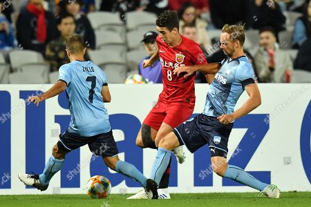 Stock Image of Michael Zullo (L) and Siem De Jong (R) Sydney FC in action against Oscar Emboaba Jr. of Shanghai SIPG during the AFC Champions League Group H soccer match between Sydney FC and Shanghai SIPG at the Jubilee Stadium in Sydney, Australia, 10 April 2019.