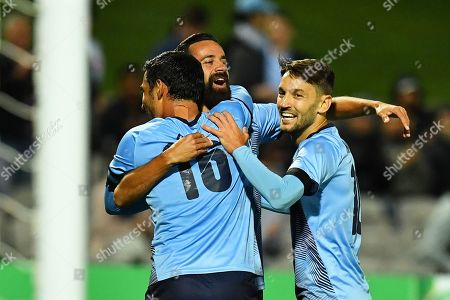 Stock Picture of Sydney's Alex Brosque (C) celebrates with his teammates Reza Ghoochannejhad (L) and Milos Ninkovic (R) after scoring the 3-2 lead during the AFC Champions League group H soccer match between Sydney FC and Shanghai SIPG in Sydney, Australia, 10 April 2019.