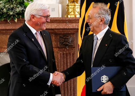 Stock Picture of German President Frank-Walter Steinmeier (L) awards the Order of Merit to former director of the Berlinale film festival, Dieter Kosslick, during a ceremony at Bellevue Palace in Berlin, Germany, 10 April 2019. The Order of Merit of the Federal Republic of Germany is awarded by the President to honor achievements of 'particular value to society'.