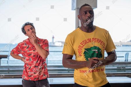 Dustin Demri-Burns and Idris Elba as Charlie