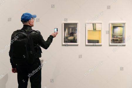 A man takes pictures of the artwork 'Tate Modern Edition' by Wolfgang Tillmans during a press preview of the exhibition 'Bauhaus and the photography - To the new seeing in the contemporary art' at the Museum of Photography in Berlin, Germany, 10 April 2019. The exhibition will open to the public from 11 April to 25 August.