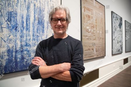 8f055a6c9c37 German artist Kris Scholz poses in front of his artworks during a press  preview of the