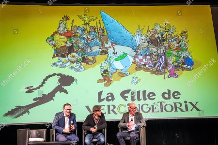 Stock Photo of French scenarist Jean-Yves Ferri (C) and Albert Rene Editions manager Celeste Surugue (L) attend a press conference for presenting the 38th album of the adventures of the two Gauls, Asterix and Obelix entitled 'La Fille de Vercingetorix' (Vercingetorix's Daughter) at the Asterix Parc  in Plailly, near Paris, France, 10 April 2019. This album will be released worldwide on 24 October 2019 and will mark the 60th anniversary of the first Asterix's album.