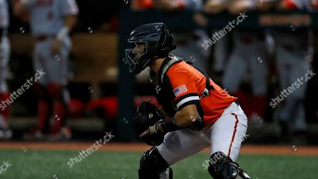 Stock Image of Gavin Johnson (43) gets ready for the throw to the plate during an Lamar University at Sam Houston State University NCAA college baseball game, in Huntsville, Texas