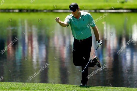 Nick Faldo reacts after making a birdie on the third hole during the par-3 golf tournament at the Masters, in Augusta, Ga