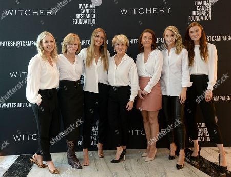 Australian former foreign minister Julie Bishop (C) poses for a photograph at the Witchery and Ovarian Cancer Research Foundation White Shirt Campaign launch in Sydney, New South Wales, Australia, 10 April 2019.