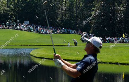 Charley Hoffman of the US (F) and Dustin Hoffman of the US with a child in the background during the 2019 Masters Tournament Par 3 Contest at the Augusta National Golf Club in Augusta, Georgia, USA, 10 April 2019. The 2019 Masters Tournament is held 11 April through 14 April 2019.