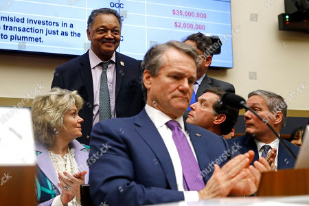 Brian Moynihan, Jesse Jackson. Rev. Jesse Jackson, back left, stands as he is introduced behind Bank of America chairman and CEO Brian Moynihan, foreground, testifies before the House Financial Services Committee during a hearing, on Capitol Hill in Washington