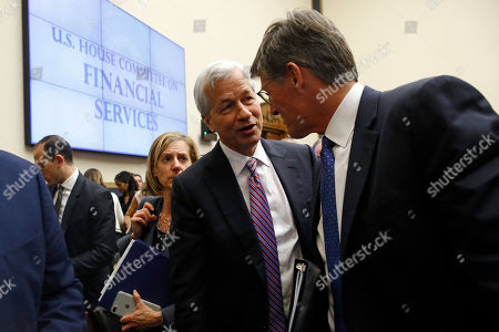 Michael Corbat, Jamie Dimon. JPMorgan Chase chairman and CEO Jamie Dimon, center, speaks with Citigroup CEO Michael Corbat during a break in testimony before a House Financial Services Committee hearing, on Capitol Hill in Washington